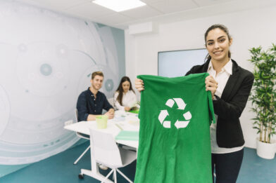 https://textilerecycling.bg/wp-content/uploads/2021/04/portrait-happy-young-businesswoman-showing-green-t-shirt-with-recycle-icon-scaled-e1619000804922.jpg